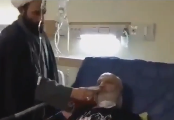 Viral video of a cleric without mask or gloves instructing Coronavirus patients in Iran to