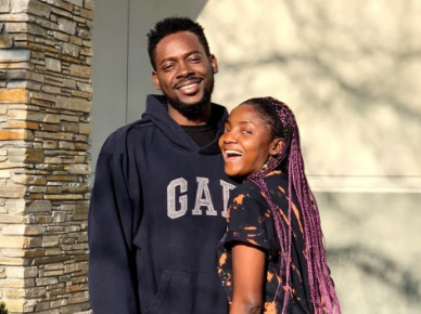 Adekunle Gold and Simi banter over which of their genes their unborn child should inherit