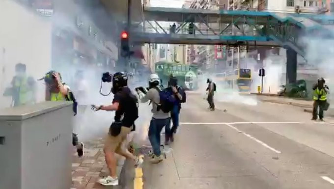 Hong Kong Police fire teargas at citizens protesting against China