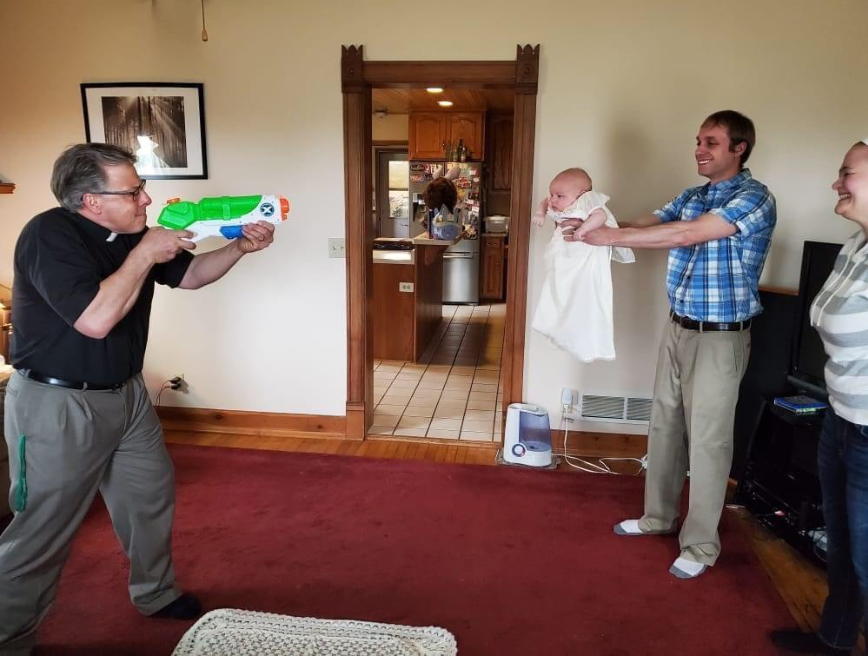 """Adorable photos of """"socially distant"""" baptism go viral (photos)"""