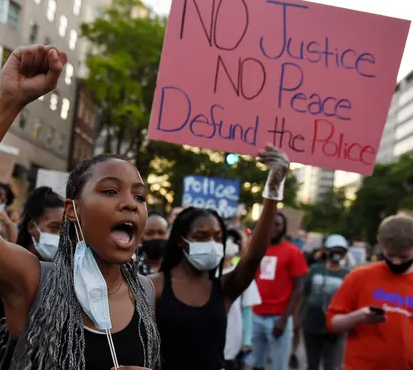 Minneapolis city council vow to disband police department in historic move