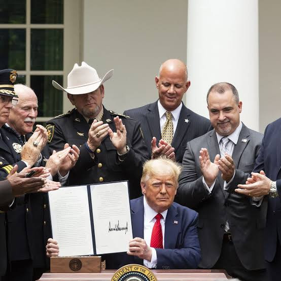 Trump signs new police reform that'll ban choke holds