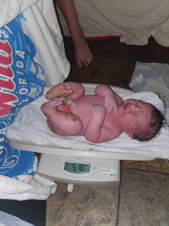 Mum gives birth during lockdown to one of Britain?s biggest babies ? weighing the same as a bowling ball  (photos)