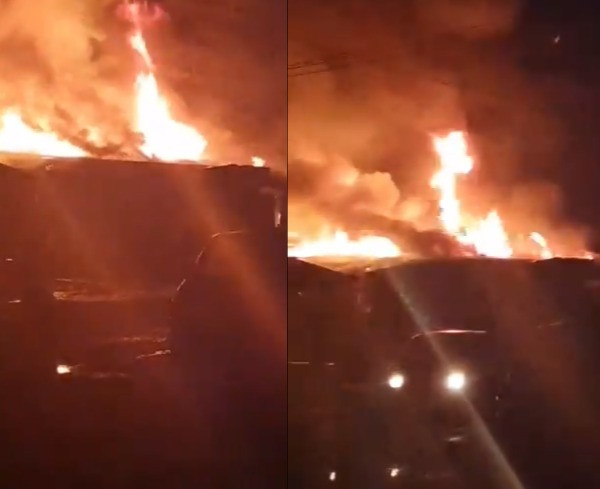 Properties worth millions of Naira destroyed as fire razes 11 shops in Lagos (photos/videos)