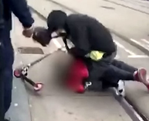 Hunt for men filmed brutally punching and kicking victim in middle of road (video)