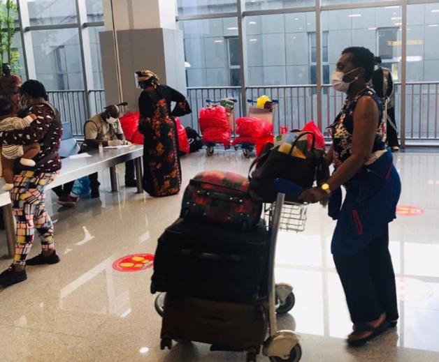 324 Nigerians evacuated from the US arrive Abuja (photos)
