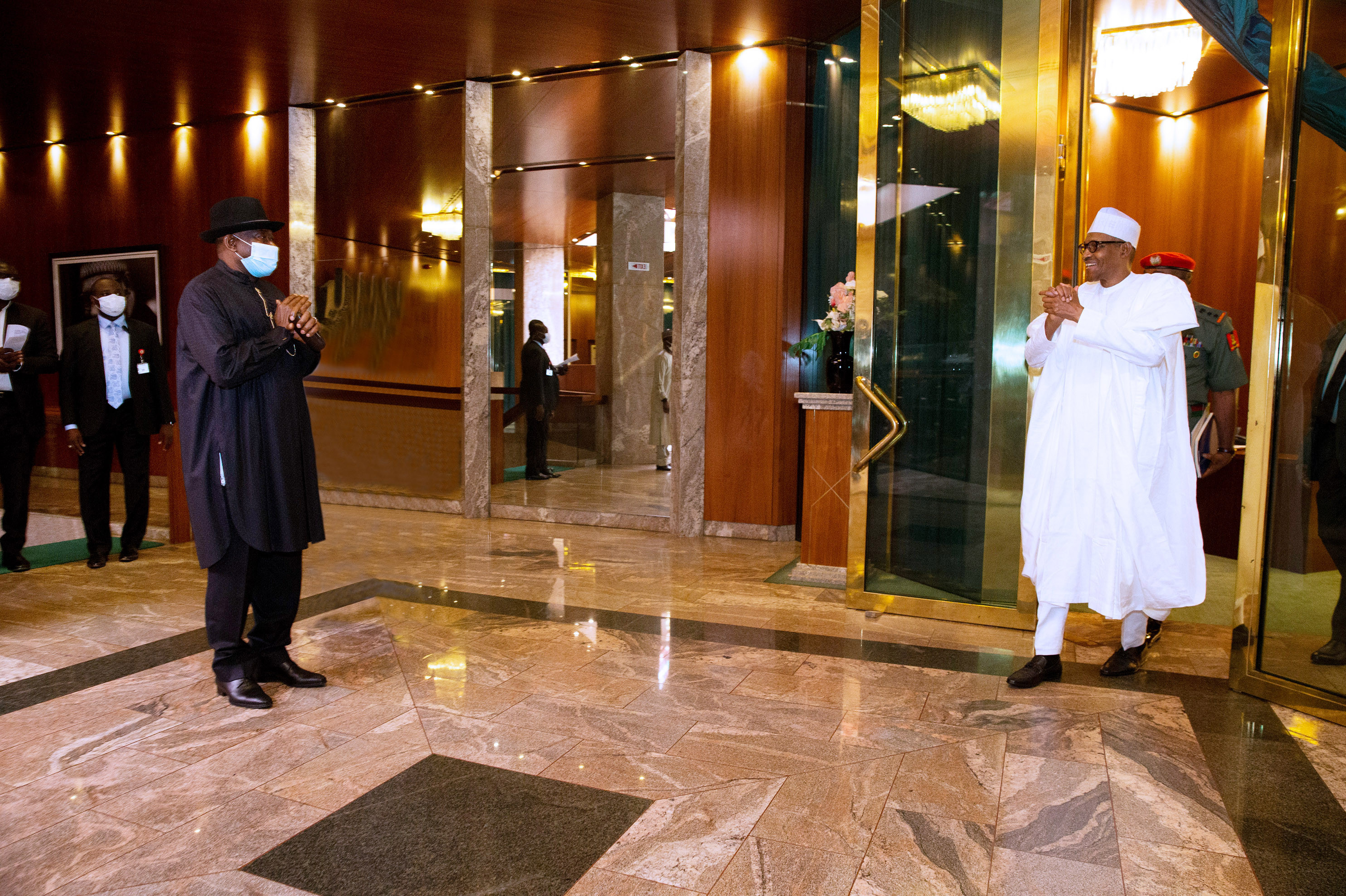 Photos of President Buhari and former president Goodluck Jonathan at the state house