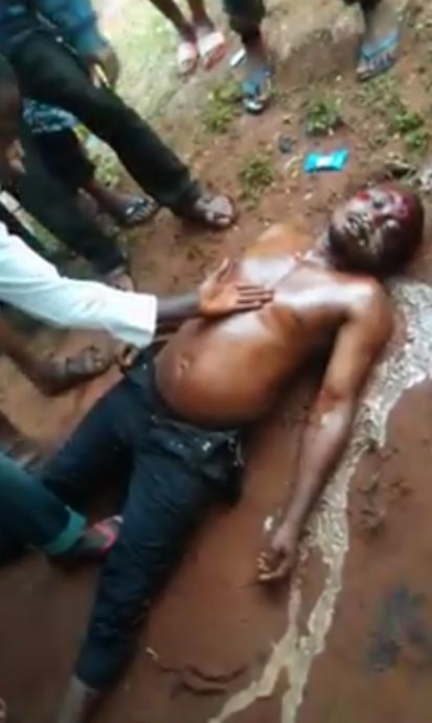 Okada rider found dead in a flooded gutter after heavy rainfall in Anambra (graphic photos)