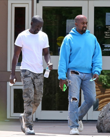 Kanye West pictured shopping for kids clothes at Walmart before visiting a bank with friend Damon Dash who denies the rapper is