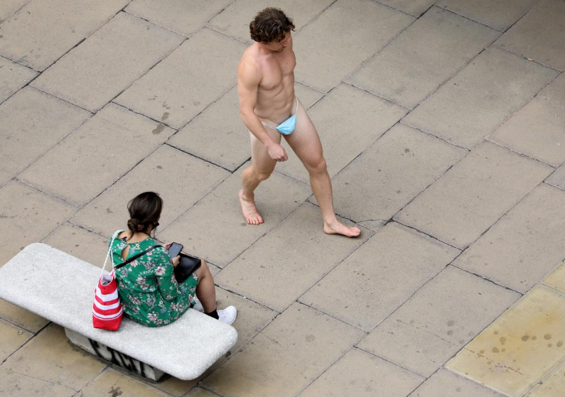Naked man strolls down Oxford Street wearing nothing but mask