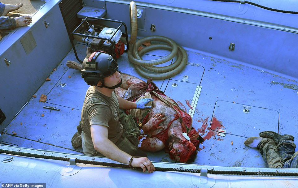 Port worker is found bloodied and alive 30 hours after being blown into the sea by the chemical explosion in Beirut (Photos)
