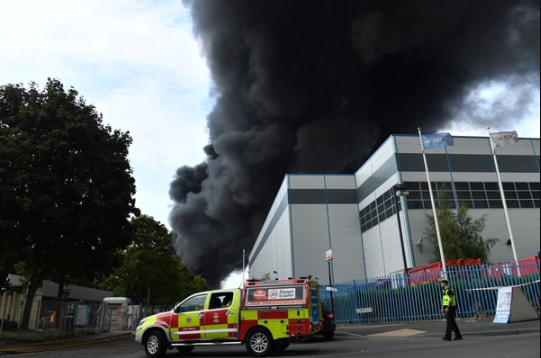 Huge fire breaks out in Birmingham and over 100 firefighters battle to put it out (video)