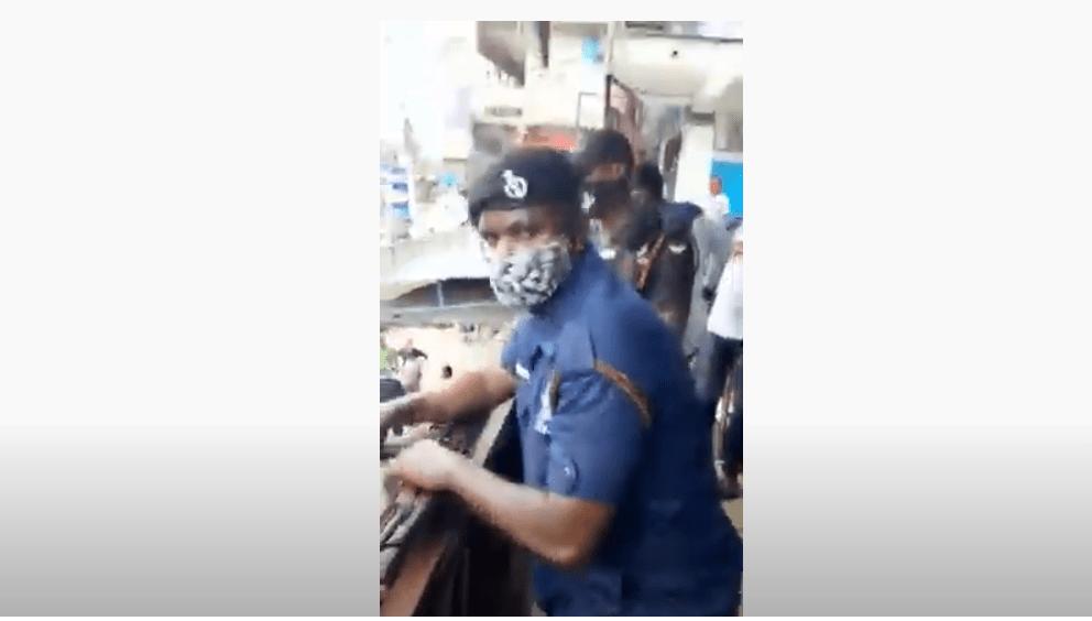 Ghanaian policemen harass and closes a Nigerian businessman