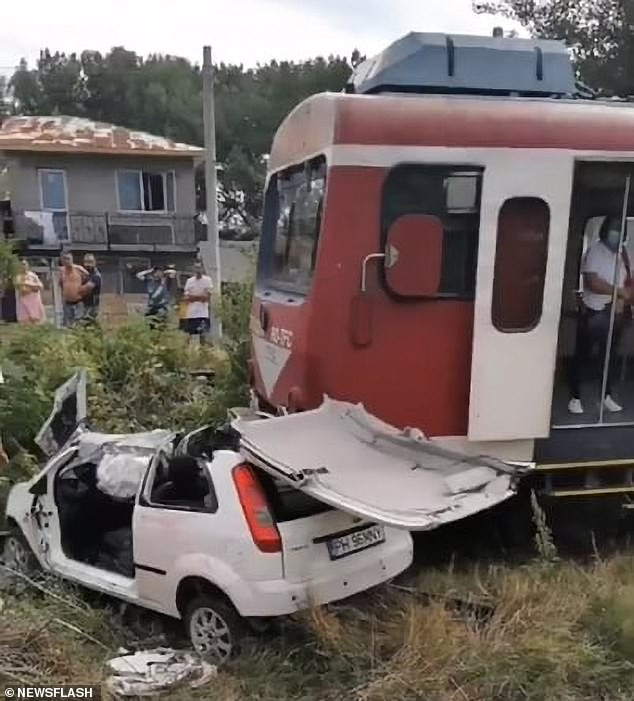 Romania singer films himself listening to loud music with his wife  in his car before being hit and killed by a train on a railway crossing (Video)