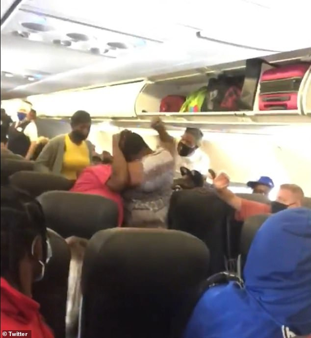 Fight breaks out in aisle of an American Airlines flight as passengers argue over face masks