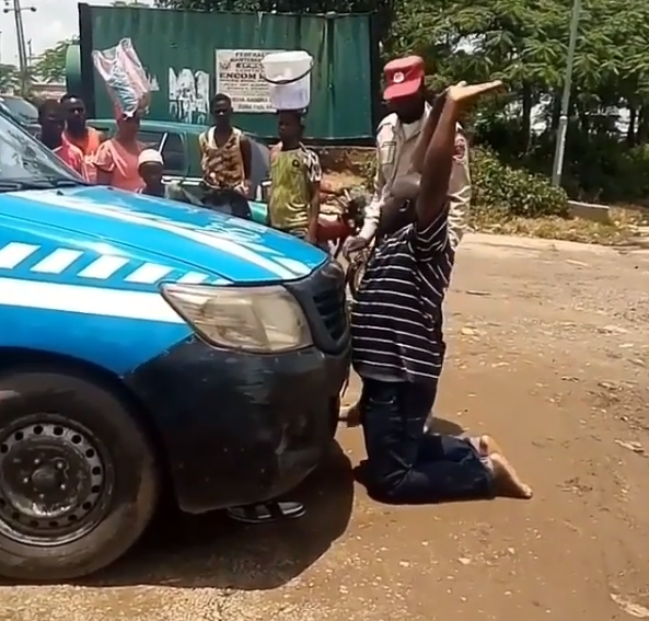 Knock me down - Man says as he kneels in front of an FRSC van while pleading for his license to be returned to him (video)