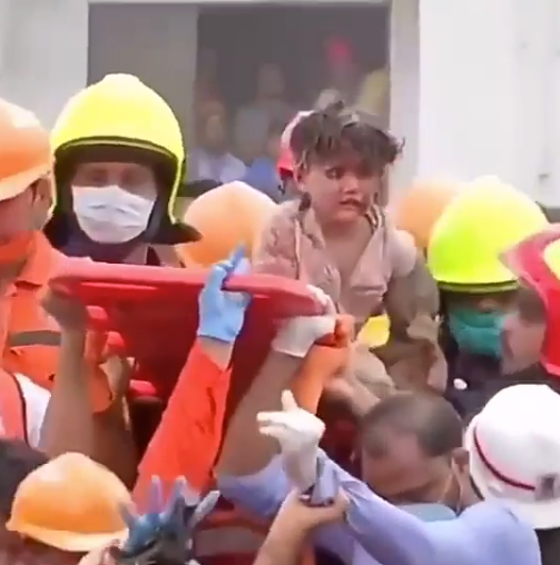 Moment 4-year-old boy buried alive in the debris of a collapsed apartment is pulled out alive nearly a full day later (video)