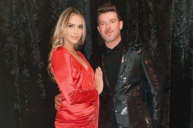 Robin Thicke and his fianc?e, April Love Geary expecting their third child?