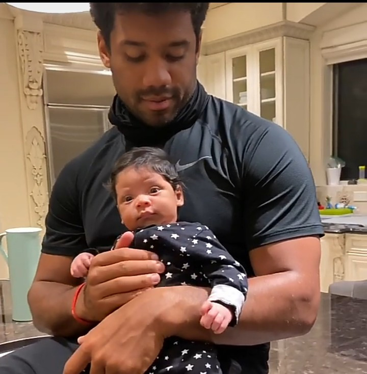Russell Wilson bonds with his newborn son, Win, in adorable video