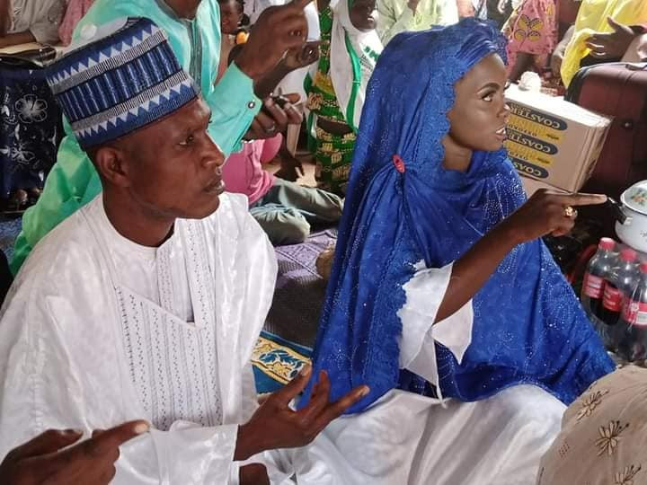 Blue-eyed Kwara woman and husband remarry (photos)