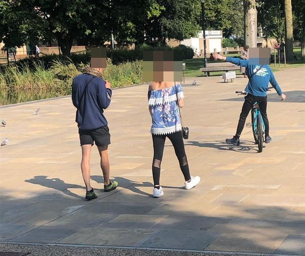 Onlookers in shock as man takes giant pet snake for walk around city centre