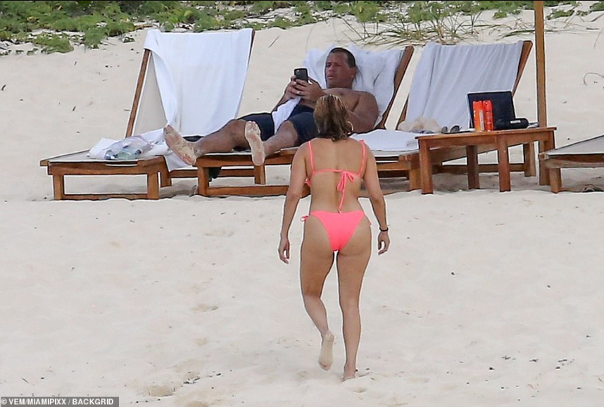 Jennifer Lopez, 51, puts her curves on display in pink bikini, for romantic beach day with fianc? A-Rod in Turks and Caicos (photos)