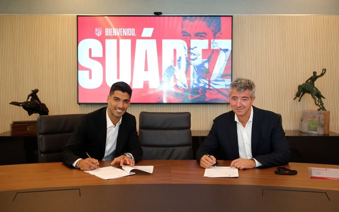 Atletico Madrid complete signing of striker Luis Suarez from Barcelona for only ?5.5m