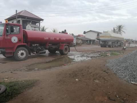 Panic as residents scoop fuel from fallen tanker in Lagos