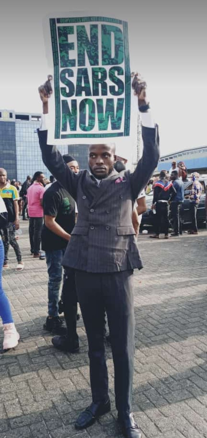 Photos of man who joined the #EndSARS protest in his wedding suit shortly after tying the knot