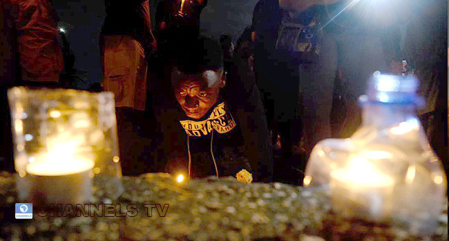 Photos as #EndSARS protesters in Abuja hold candlelight procession