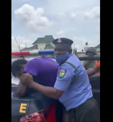 Nigerian lady accuses police officers of assaulting her after she tried to help a ?hungry pedestrian? they were allegedly manhandling over face mask (video)