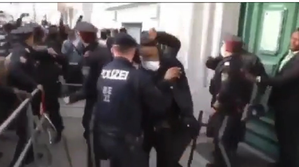 Police scramble to safeguard the Nigerian envoy to Austria as angry Nigerians attack him (video)
