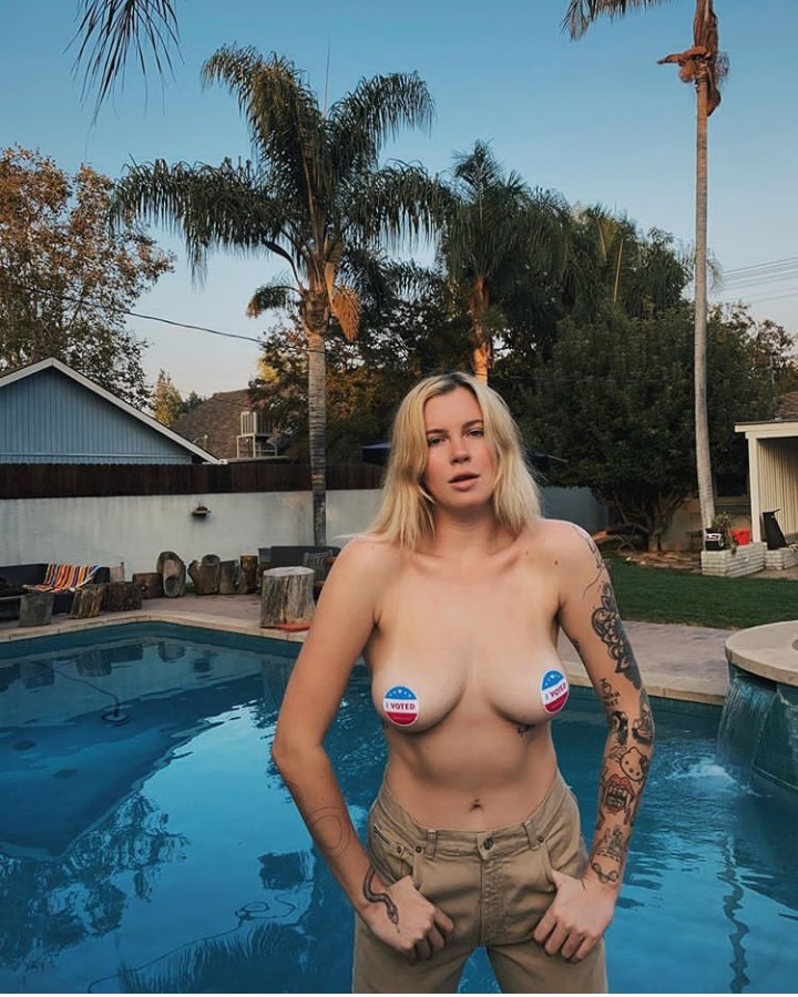 Model Ireland Basinger Baldwin lets her breasts hang out as she urges people to vote (photos)