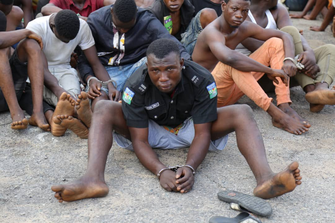 Police parade hoodlum who participated in attacking a police station and went away with the DPO