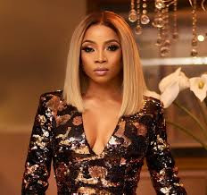 Toke Makinwa reacts after some Nigerians alleged she was paid by the govt to claim she had COVID19