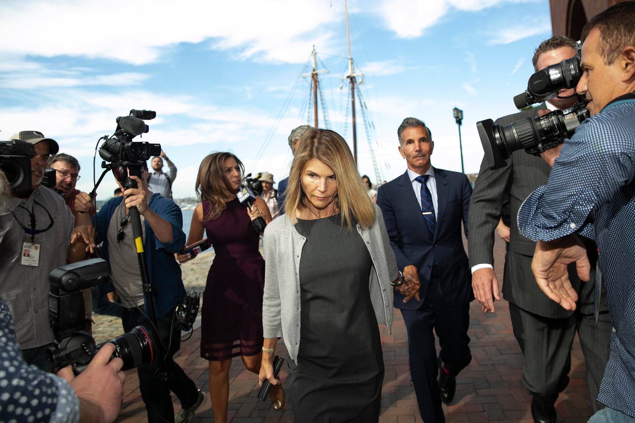 Actress Lori Loughlin reports to prison after pleading guilty in the college admissions scandal