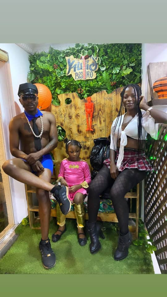Seun Kuti, his partner and their daughter step out in their Halloween costumes
