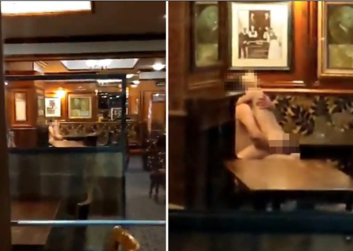 Naked couple caught romping inside a bar in full view of passersby (18+)
