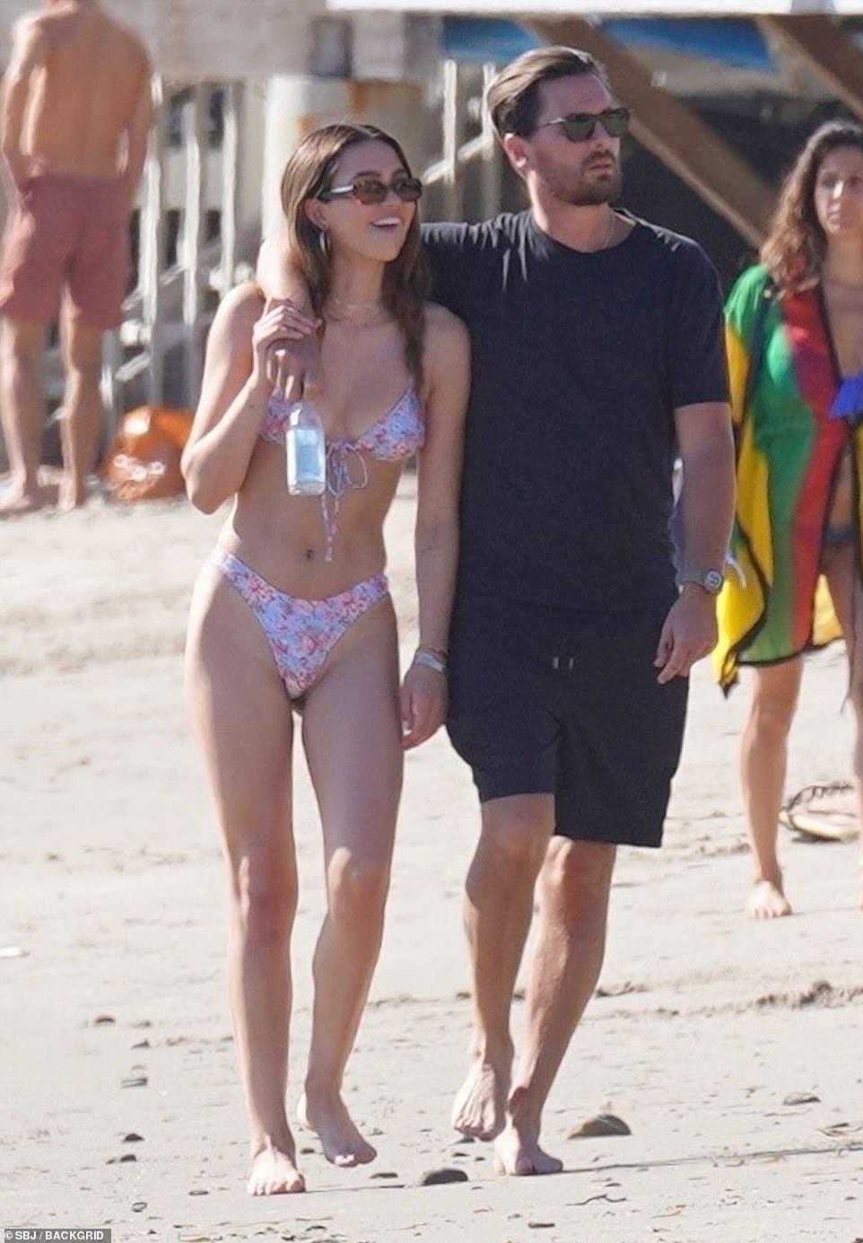 Scott Disick, 37, hits the beach with 19-year-old Amelia Hamlin