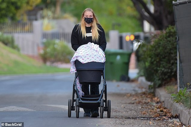 Games of Thrones star, Sophie Turner pictured out on an afternoon stroll with 3-month-old daughter Willa