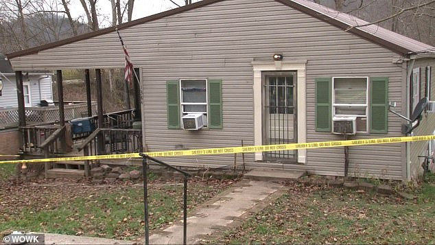 16 year old boy charged with murder after parents and two brothers, aged three and 12, are shot dead in their family home in West Virginia