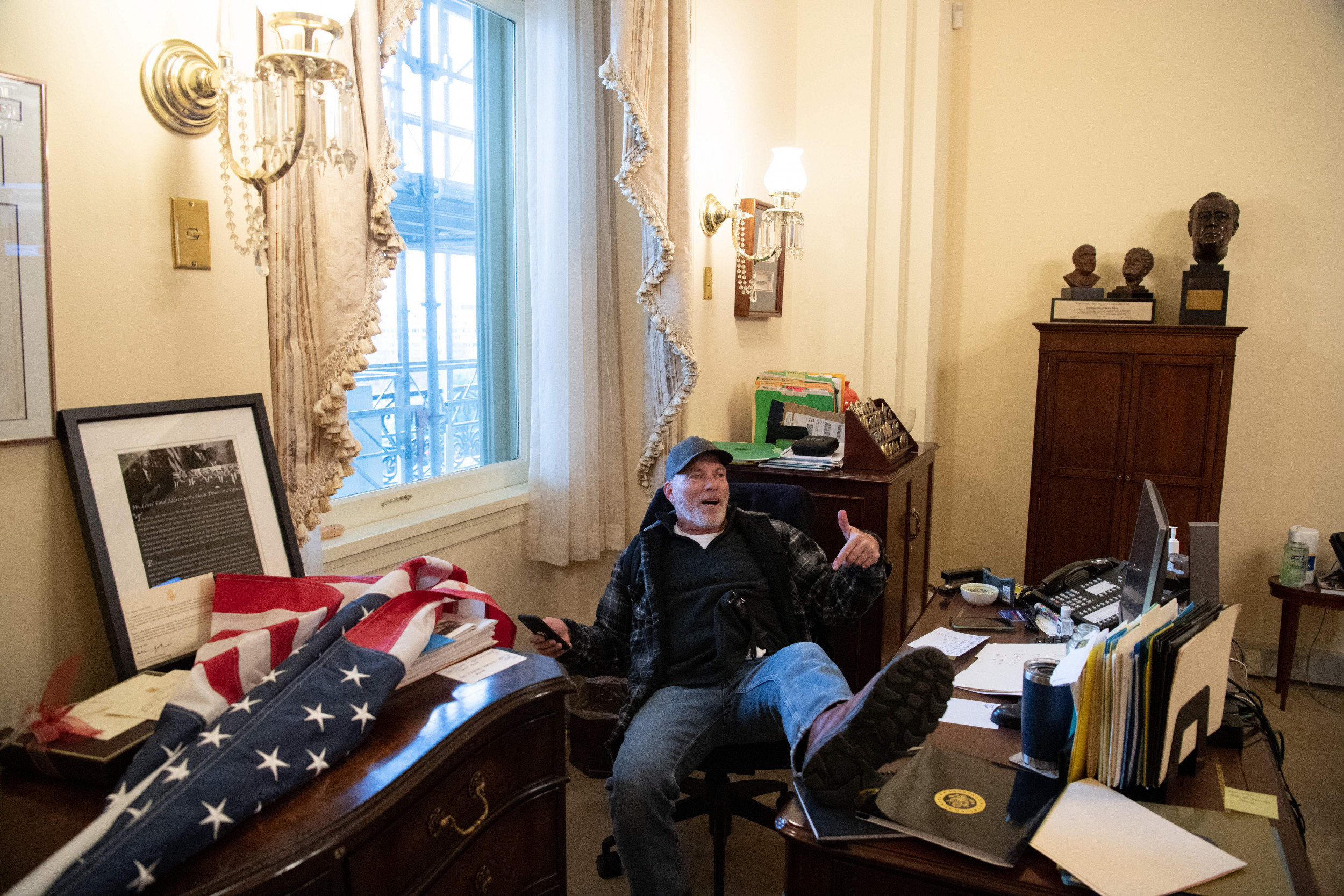 Richard Barnett, the man seen sitting at Speaker Nancy Pelosi?s desk during Wednesday