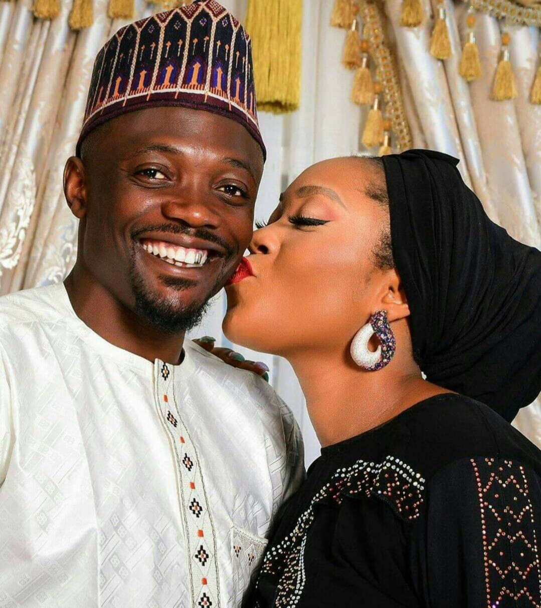 Ahmed Musa called out by Muslims for posting photo of his wife kissing him on the cheek