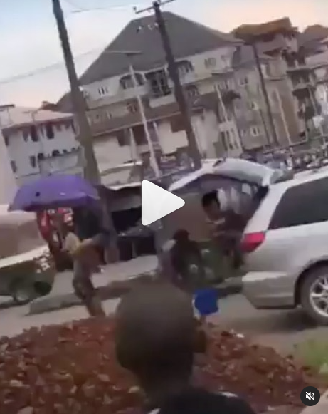 Suspected yahoo boys bath in the middle of the road as a native doctor performs ritual on them in Abia (video)
