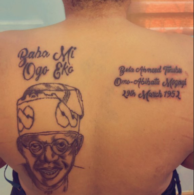 Lady tattoos Bola Tinubu