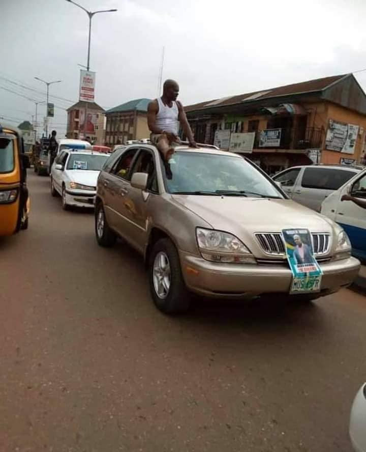 """Man rumoured to have died in an accident parades the village in a motorcade and a poster that reads """"Aiza Nwosu is awake"""""""