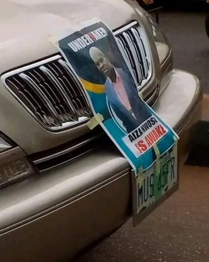 "Man rumoured to have died in an accident parades the village in a motorcade and a poster that reads ""Aiza Nwosu is awake"""