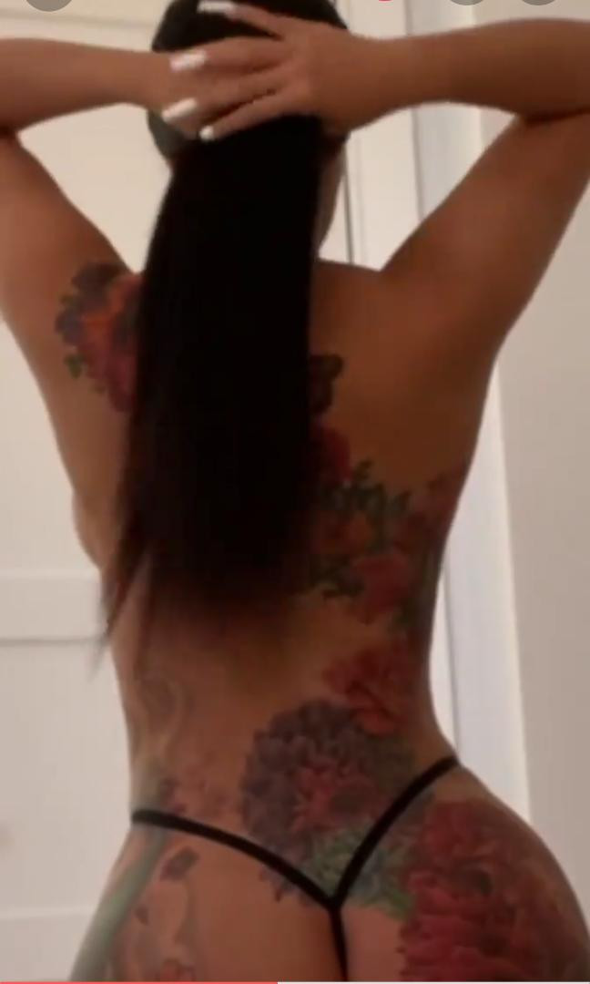 Cardi B strips down to just her g-string to show off her massive back tattoo (video)