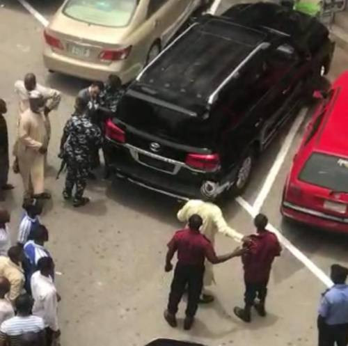 Moment Code of Conduct Tribunal Chairman was almost mobbed for assaulting a security guard at Abuja Plaza (video)