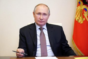 Vladimir Putin signs legislation that formally grants him the right to stay in power until 2036